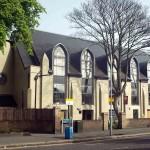 A cream and black converted church