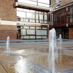 Water features in front of an apartment building
