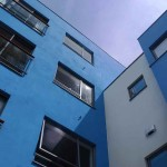 A blue and white apartment building