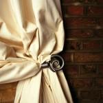 A close up of a cream curtain